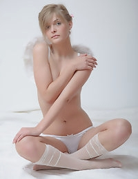 Adorable teen cutie posing with cute angel wings on the back and stripping totally nude.