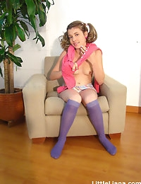Liana very hot sitting in couch