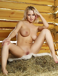 What's better than a nude blonde in a barn? Having photos of it.  Very hot.