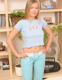 Pretty teen blonde gets rid of her underclothes so that to pose in the altogether for you.