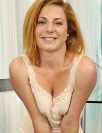 Redhead Ritta enjoys piss play on camera