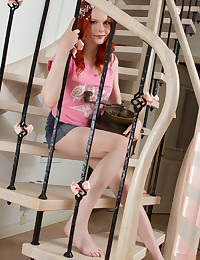 Hot redhead strips all her clothes of as she goes down the stairs and starts fingering all her tight little holes.