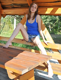 Hot teen gets naked and sexy on a picnic table, where she gives glances of her sexiness and juicy little pussy.