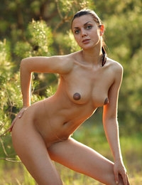 Lovely model Macy gets frisky on the road posing absolutely nude